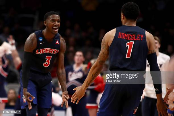 Lovell Cabbil Jr #3 of the Liberty Flames reacts to a play against the Mississippi State Bulldogs during their game in the First Round of the NCAA...