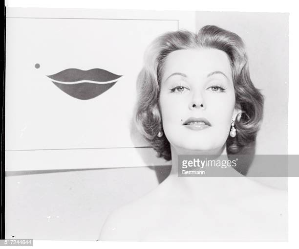 Lovely actress Arlene Dahl's natural beauty mark and shapely lips have been incorporated into one of Hollywood's most glamourous calling cards The...