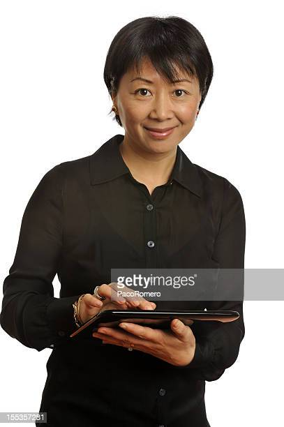 Lovely Asian executive with modern tablet computer