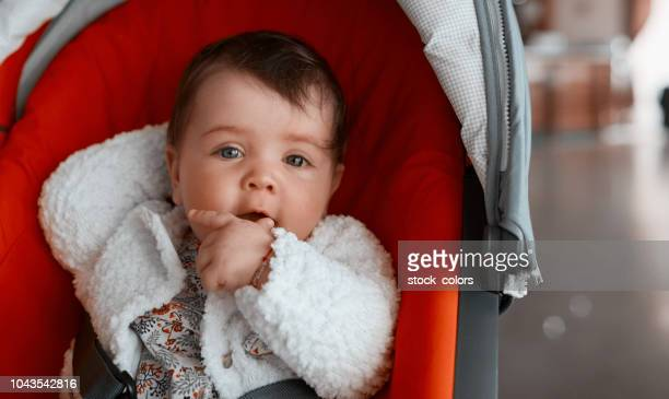 lovely baby girl - baby carriage stock pictures, royalty-free photos & images