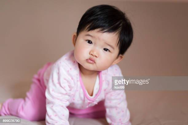 a lovely baby less than one year old - cute little asian girls stock photos and pictures