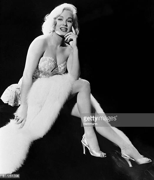 Lovely Blonde Actress Mamie Van Doren poses prettily and makes it look easy. However, Mamie Assures us that making this kind of picture is really...