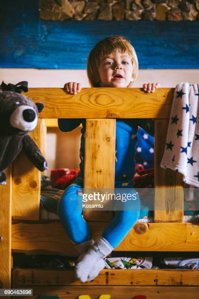 Lovely Boy Enjoying Leisure Day In Bunk Bed