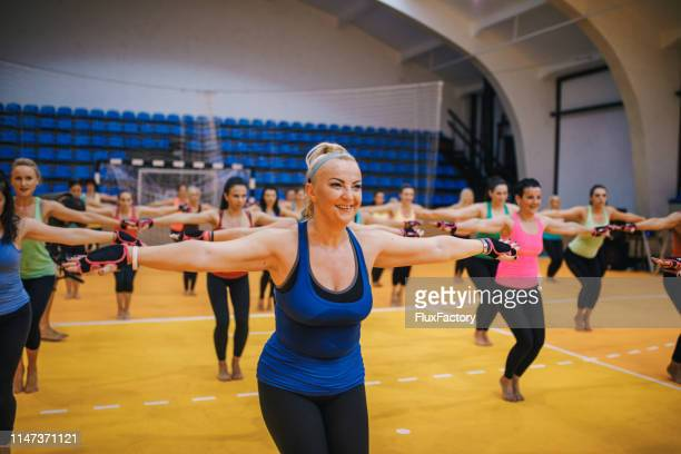 lovely cheerful women enjoying exercising together - leisure facilities stock pictures, royalty-free photos & images