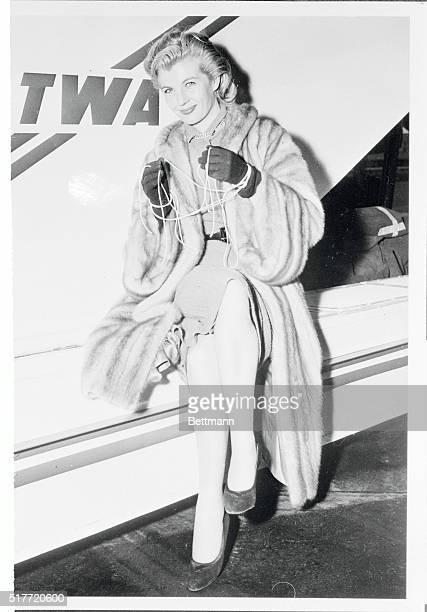 Lovely Corinne Calvet Demonstrates the dissolution of her marriage ties as she arrives at New York's International Airport enroute to her Native...