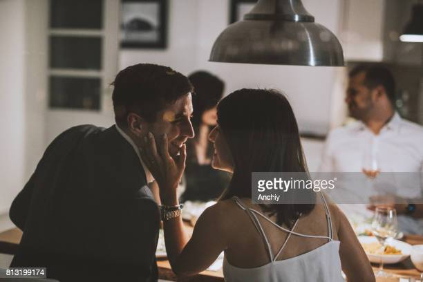 a lovely couple at friend's place having dinner - four people stock pictures, royalty-free photos & images