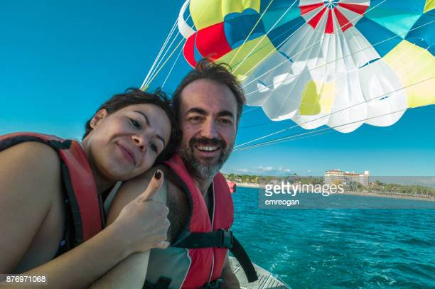 lovely couple before parasailing - antalya province stock pictures, royalty-free photos & images
