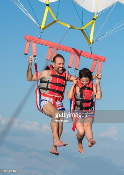 Lovely couple during parasailing