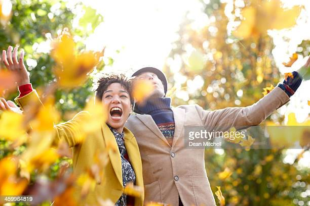 lovely couple enjoying autumn - autumn falls stock pictures, royalty-free photos & images