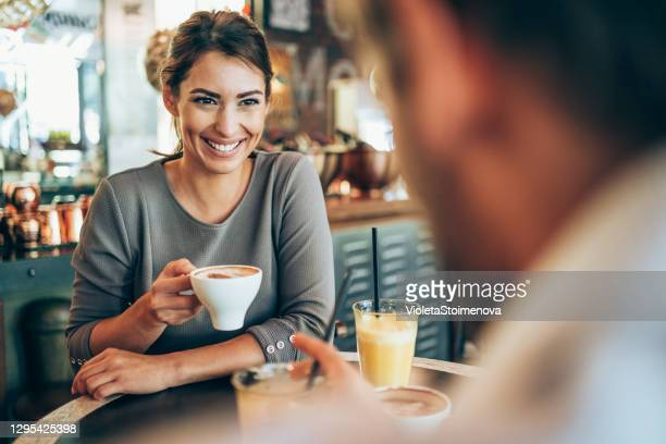 lovely couple having date in a cafe. - flirting stock pictures, royalty-free photos & images