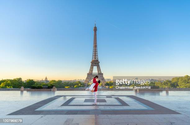 lovely couple in front of the eiffel tower, paris, france - i love you stock pictures, royalty-free photos & images