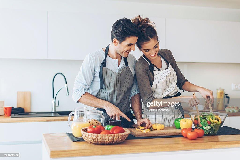 Lovely couple making salad : Stock Photo