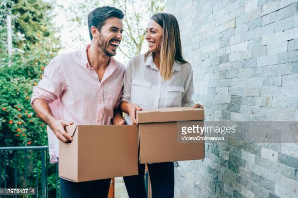 lovely couple moving into new house. - entering stock pictures, royalty-free photos & images