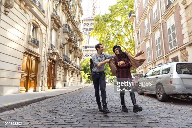 lovely couple spending some days in vacation to paris - monument stock pictures, royalty-free photos & images