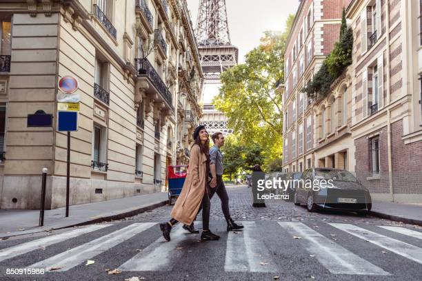 lovely couple spending some days in vacation to paris - travel destinations stock pictures, royalty-free photos & images