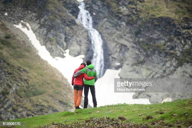 Lovely couple  watching a waterfall