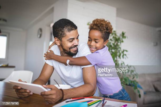 lovely daughter embracing her father - homeschool stock pictures, royalty-free photos & images