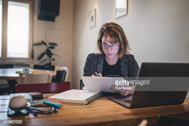 lovely design student working at home - adult stock pictures, royalty-free photos & images
