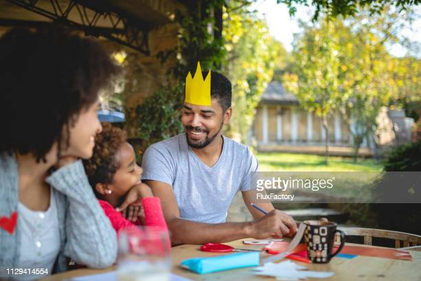 lovely family having fun while doing a art project for school - royal person stock pictures, royalty-free photos & images