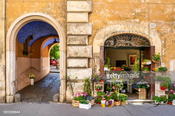 a lovely flower shop near an underpass in the historic and baroque heart of rome - image title stock pictures, royalty-free photos & images