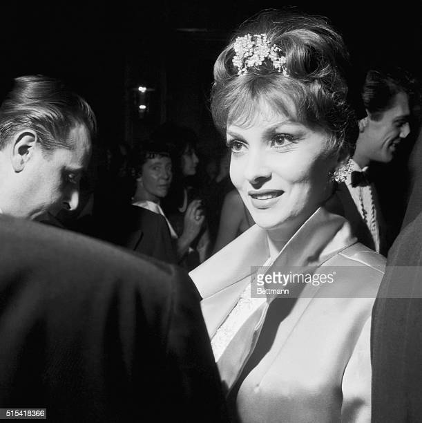Lovely Gina Lollobrigida enjoys an animated conversation at the starstudded party which actress Elizabeth Taylor gave at the Grand Hotel in Rome The...