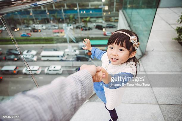 lovely girl leading her dad to glass fence - leanintogether stock pictures, royalty-free photos & images