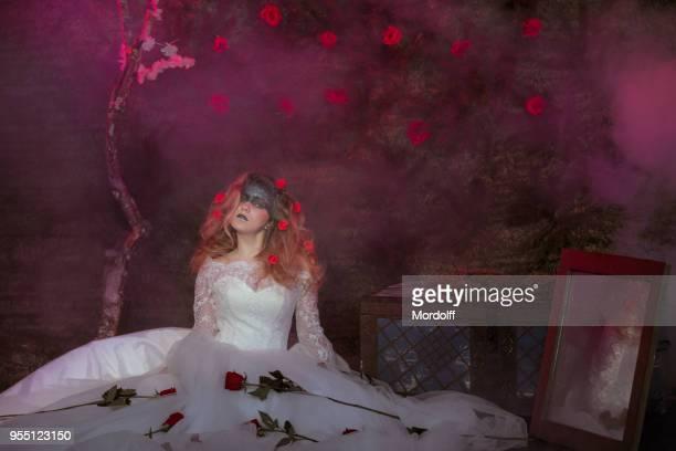 lovely girl sitting under blossom dead tree - dead girl imagens e fotografias de stock