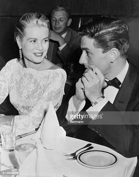 Lovely Grace Kelly in New York for a brief vacation chats with Jay Kanter at the Stork club She is to seen in the movie Rear Window