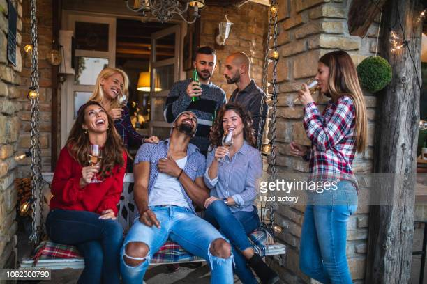 lovely group of friends having a celebration together - casal heterossexual imagens e fotografias de stock