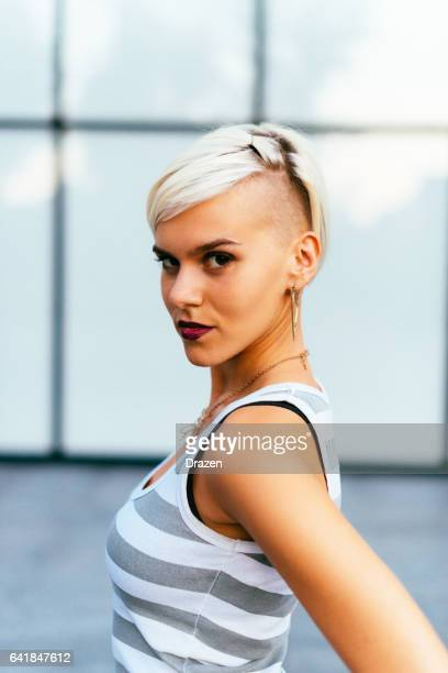 lovely hipster young woman portrait in casual clothing - half shaved hairstyle stock pictures, royalty-free photos & images