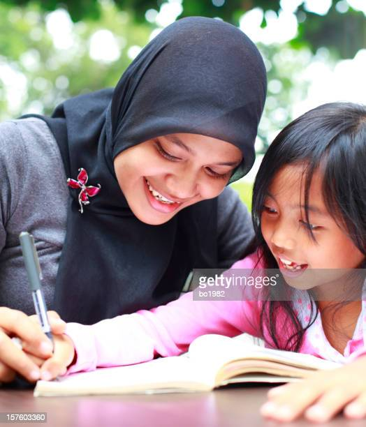 lovely indonesian little girl doing homework