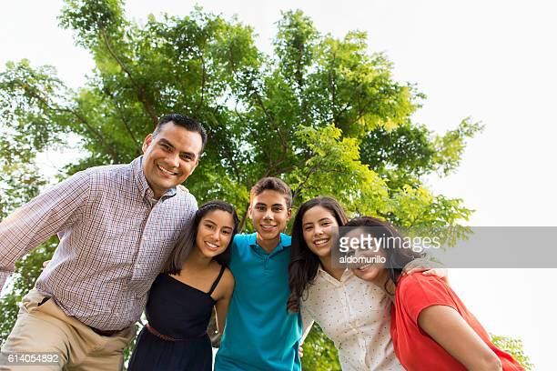 Lovely latin family smiling at camera