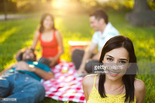Lovely latin woman at a picnic
