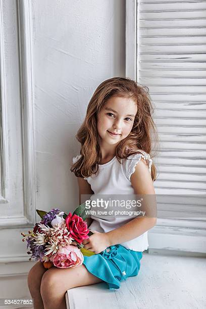 lovely little girl about 6-7 years with flowers - 8 9 years stock pictures, royalty-free photos & images