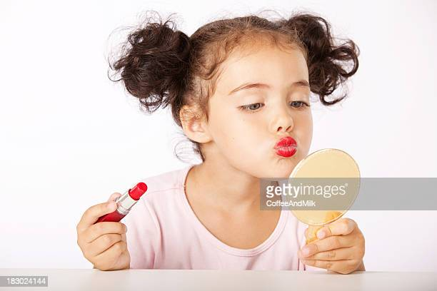 lovely little girl making makeup - girl in mirror stock photos and pictures