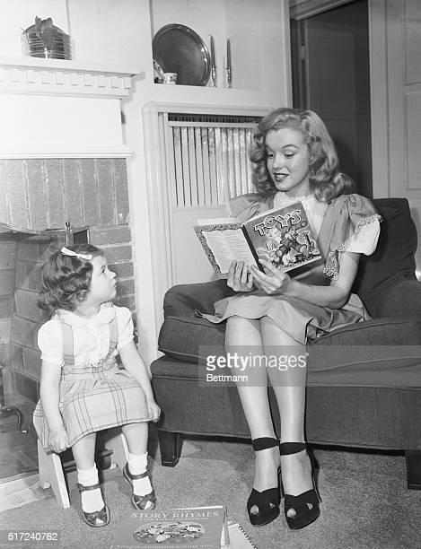 Lovely Marilyn Monroe, former baby sitter now turned actress, proves that she hasn't lost any of her appeal for children. Marilyn landed a contract...