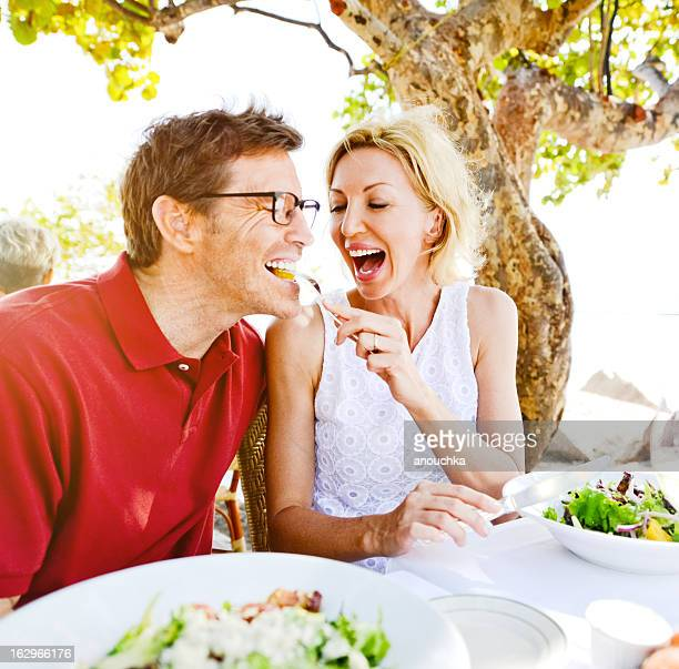 Lovely Mature Couple Enjoying Food in a Restaurant