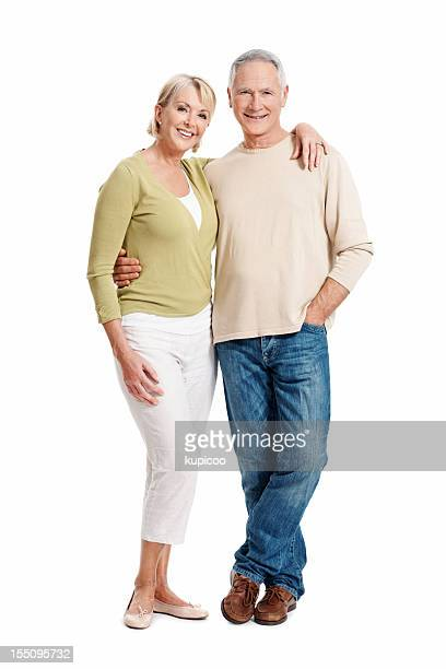 Lovely mature couple smiling at you