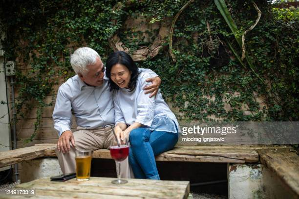 lovely mature taiwanese couple at outdoor cafe - taiwan stock pictures, royalty-free photos & images