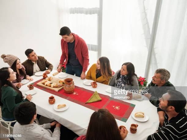 lovely mexican family sitting at table on three kings day - roscon de reyes stock pictures, royalty-free photos & images