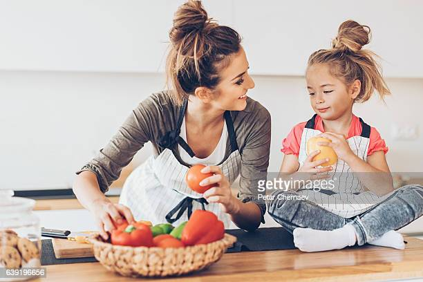 Lovely mother and daughter with fresh vegetables
