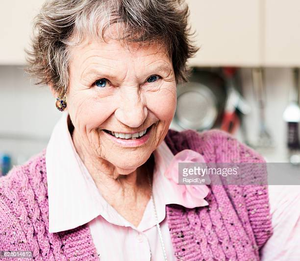 Lovely old lady with twinkling eyes smiles happily