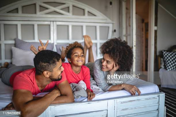 lovely playful mixed ethnicity family at home - family at home stock photos and pictures