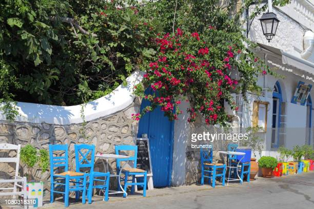 lovely promenade tavern at spetses island, greece - spetses stock pictures, royalty-free photos & images