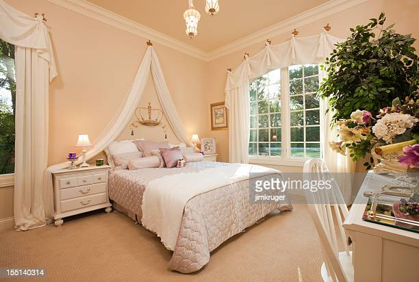 Lovely queen themed bedroom in residential home.