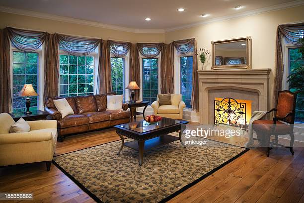 Lovely residential living room with burning fireplace.