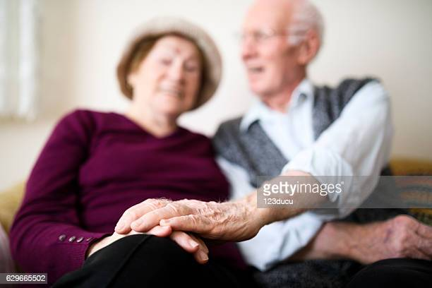 lovely senior couple at home - respite care stock photos and pictures