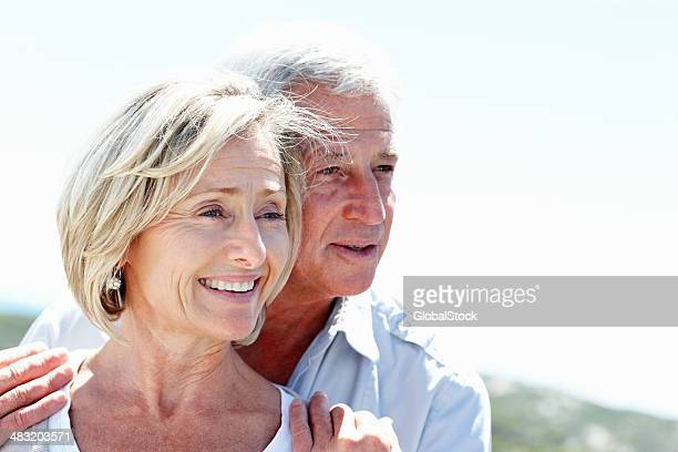 Lovely senior couple in love looking at copyspace