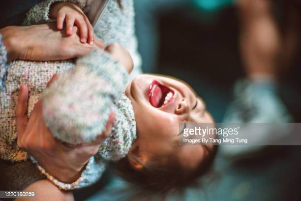 lovely toddler playing joyfully with mom - tickling stock pictures, royalty-free photos & images