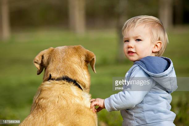Lovely toddler with a dog